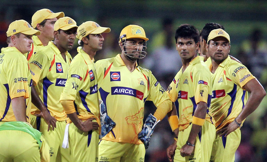 File photo of CSK Skipper M.S. Dhoni with his teammates. Chennai Super Kings has been suspended for 2 years by the Supreme Court-appointed Justice Lodha Committee, July 14, in connection with the IPL scam. (Press Trust of India)