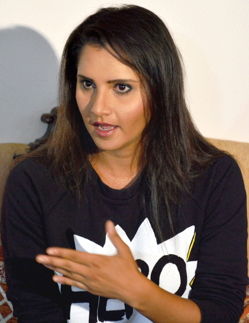 Sania Mirza addressing a media conference at her residence, in Hyderabad, July 14. Mirza recently won the doubles title at Wimbledon. (Press Trust of India)