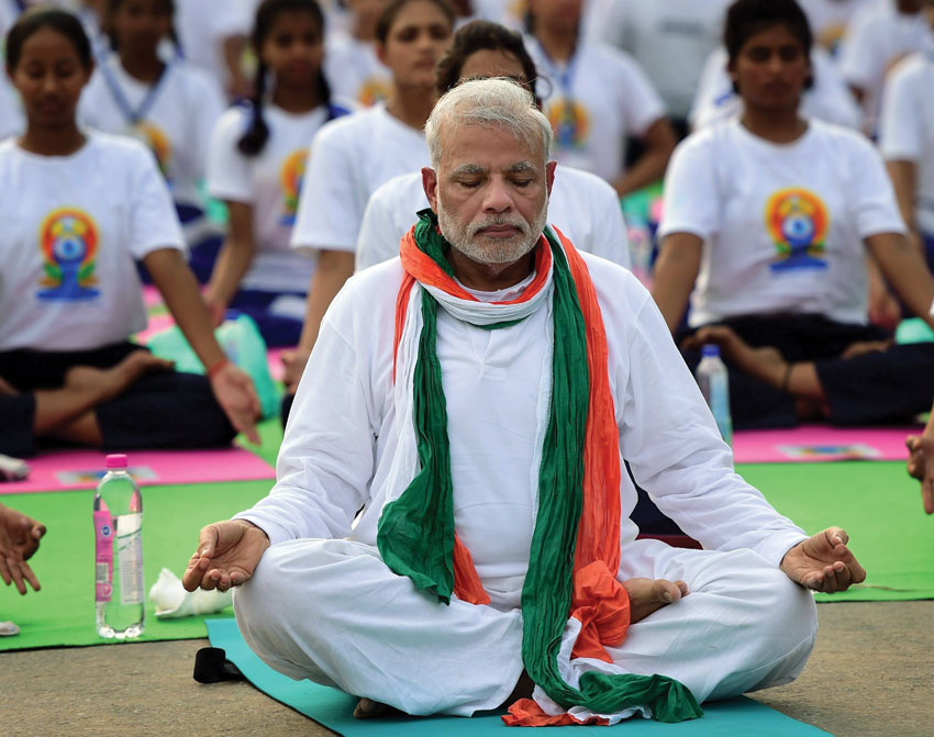 Prime Minister Narendra Modi (front) performs yoga along with thousands of others at a mass yoga session to mark the International Day of Yoga 2015 at Rajpath in New Delhi, June 21. (Manvender Vashist | PTI)