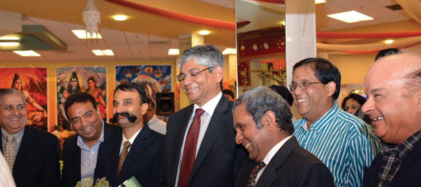 Ambassador Arun K. Singh (c), Consul General of India, San Francisco, Ambassador Venkatesan Ashok (3rd from r), Debabrata Chattopadhyay, Consul and Head of Chancery, CGI SF (3rd from l); offering prayers along with Sunnyvale Temple board members Balwant Birla (l), Raj Bhanot (2nd from l), and Sanjay Agarwal (2nd from r) at Sunnyvale Hindu Temple, July 24. (Amar D. Gupta | Siliconeer)