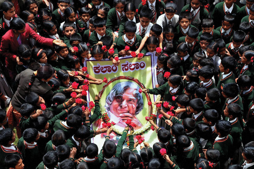 Students paying tribute to the former President A.P.J. Abdul Kalam at a school in Chikmagalur, July 28. (Press Trust of India)