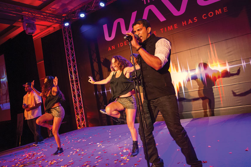 "Latin-Indian fusion pioneer and ESPN-featured, Giju John performed his new single, ""Mas' Bhangraton,"" featuring Los Angeles-based hip-hop artist Mixman Shawn with dancing by the nation's hottest Indian fitness craze, BollyX. (Preston Merchant)"