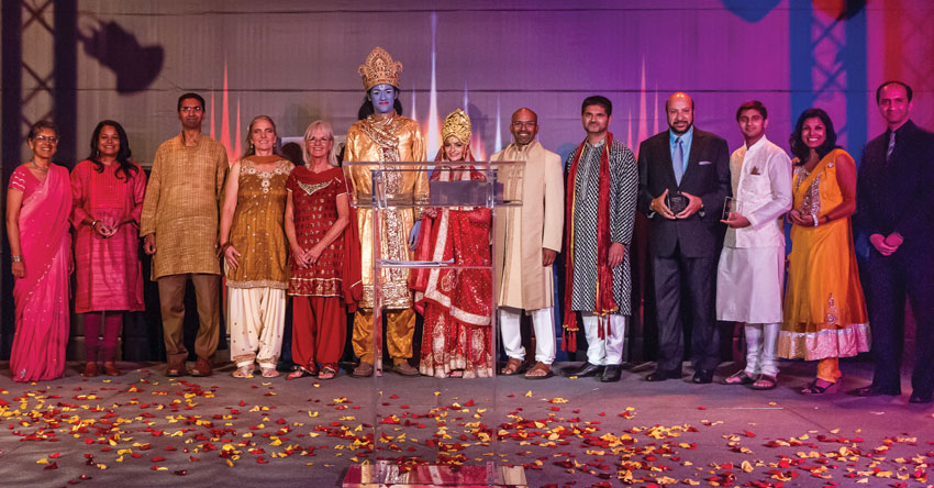 "In addition to the entertainment, Incredible India had the opportunity to honor Indian Americans doing something incredible.  The five Outstanding Achievement award winners were; Saagar Gupta (3rd from r), Dr. Lipi Roy (2nd from r), Ray Walia (4th from r), Shalini Nataraj (2nd from l), Mount Madonna School's Ramayana accepted by co-producers Nicole Tervalon and Anurag Christine White (4th and 5th from l) along with ""Lord Ram"" and ""Princess Sita"" characters. (Preston Merchant)"