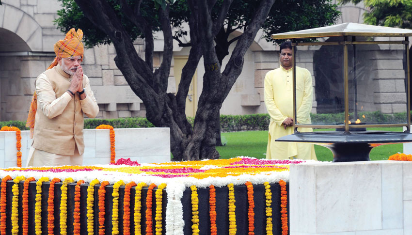 Prime Minister Modi paying homage at the samadhi of Mahatma Gandhi, at Rajghat, on the occasion of 69th Independence Day, in Delhi, Aug. 15. (Press Information Bureau)