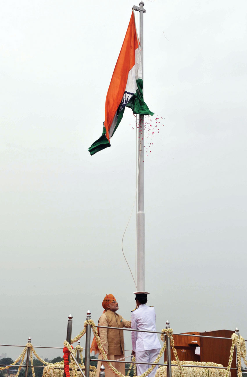 Prime Minister Narendra Modi unfurling the Tricolor flag at the ramparts of Red Fort, on India's 69th Independence Day, in Delhi, Aug. 15. (Press Information Bureau)