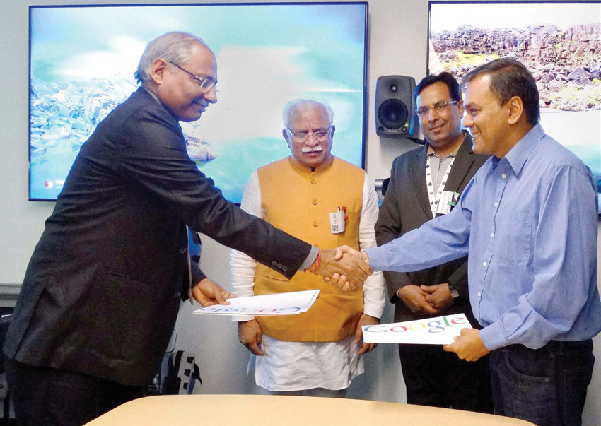 Haryana Principal Secretary Industries Devender Singh and a representative of Google after signing a MoU in the presence of Chief Minister Manohar Lal Khattar and Industries Minister Capt. Abhimanyu in San Francisco, Aug. 21. (Press Trust of India)