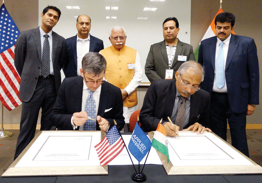 Haryana Principal Secretary Industries Devender Singh and a representative of Applied Material signing a MoU in the presence of Chief Minister Manohar Lal Khattar and Industries Minister Capt. Abhimanyu in San Francisco, Aug. 21. (Press Trust of India)