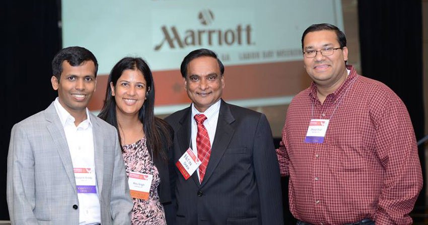 NetIP NA 2014 executive team members Manjesh Reddy, Ritu Singh, and Dhaval Shah with Fast Pitch Competition Judge Nitin Shah at the 2014 Annual NetIP NA Conference in Atlanta, GA. (ByteGraph Productions)