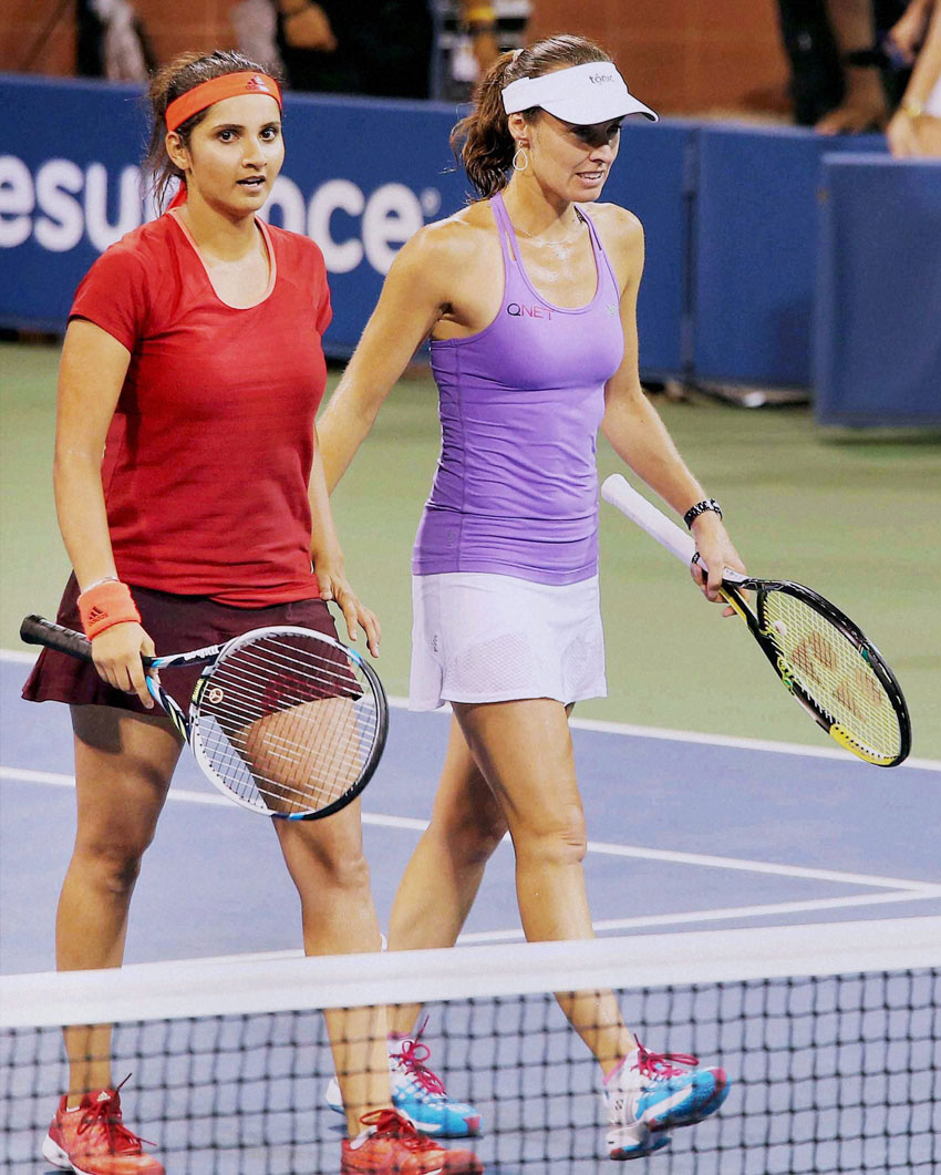 Sania Mirza and partner Martina Hingis after winning the doubles semifinal match against the Italian pair of Sara Errani and Flavia Pennetta at the U.S. Open at Flushing Meadows in New York, Sept. 9. (Press Trust of India)