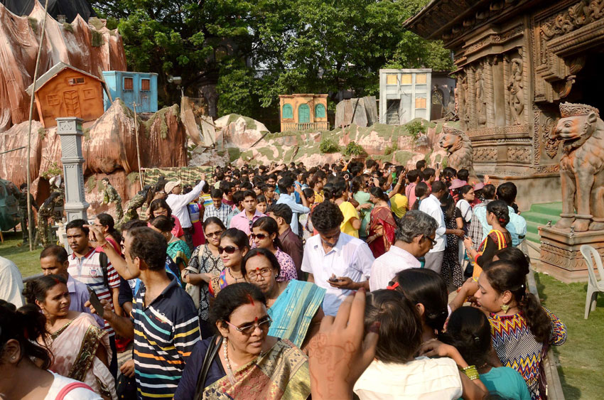 "People visiting Durga Puja pandal themed as ""Nepal earthquake and rescue by Indian Army,"" in Kolkata, Oct. 19. (Press Trust of India)"