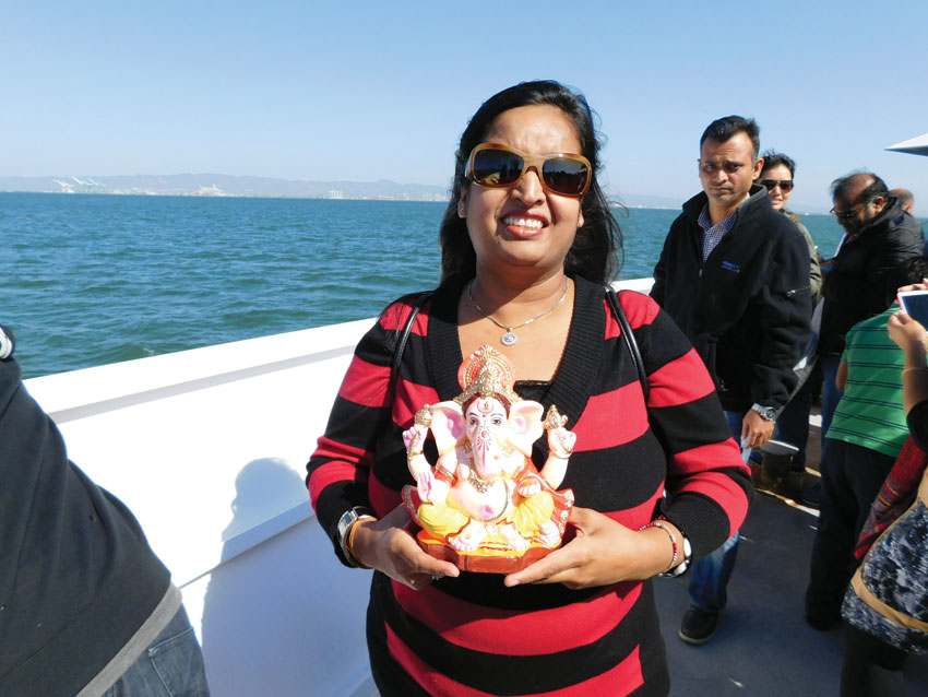 Siliconeer co-publisher Seema Gupta holds a small Ganesh idol in San Francisco. (Vansh A. Gupta | Siliconeer)