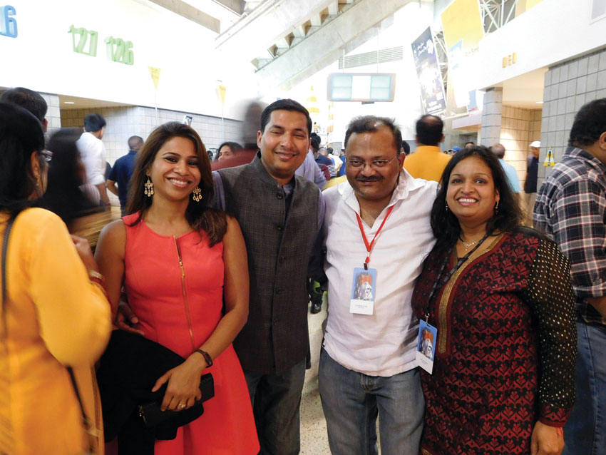 (R-l): Siliconeer co-publisher Seema Gupta, Siliconeer editor Amar D. Gupta, Kislay Banka and Sonal Banka in a festive mood, ready to greet Prime Minister Modi at the SAP Center, Sept. 27. (Vansh A. Gupta | Siliconeer)