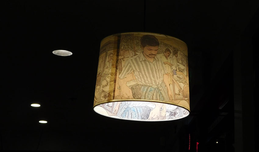 Lamp shade with pictures of a South Indian kitchen.