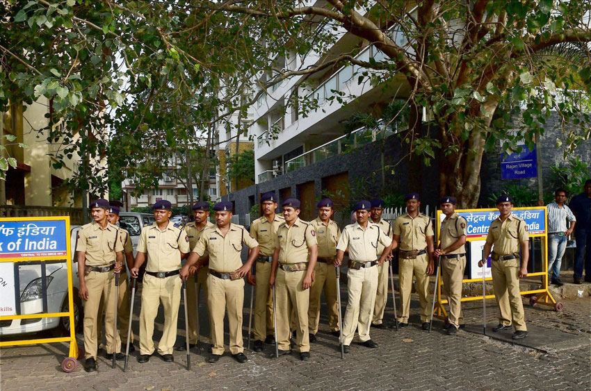 Police stand guard outside the residence of Aamir Khan following his comment on growing intolerance in India, in Mumbai, Nov. 24. (Mitesh Bhuvad | PTI)