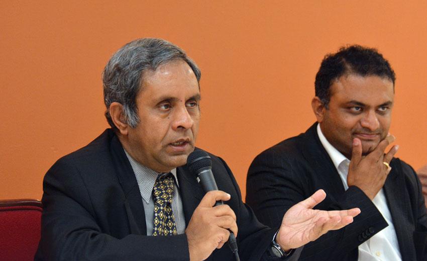 Consul General of India, San Francisco, Ambassador Venkatesan Ashok talks to media as Deputy Consul General of India, San Francisco, Dr. K.J. Srinivasa looks on.