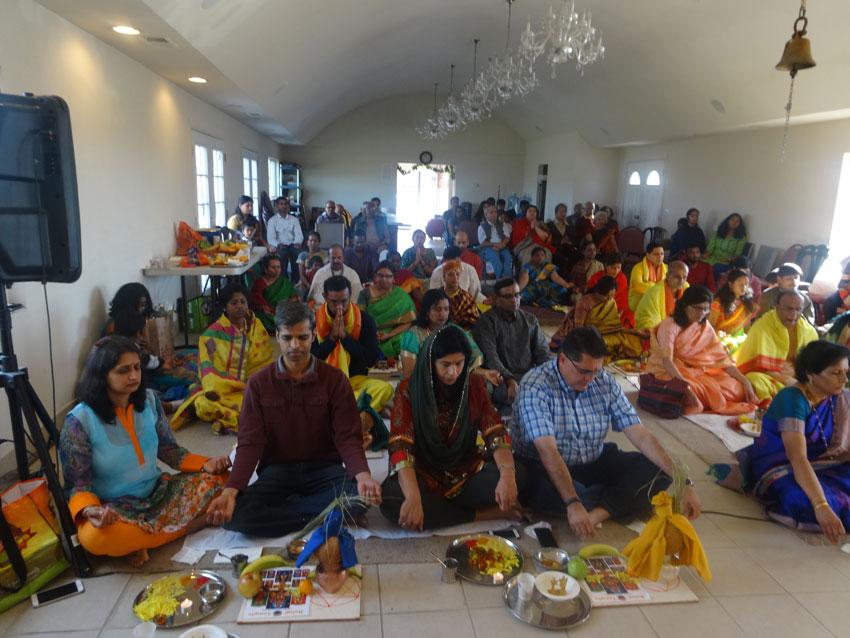 "Devotees performing ""Satyanarayana Pooja."""