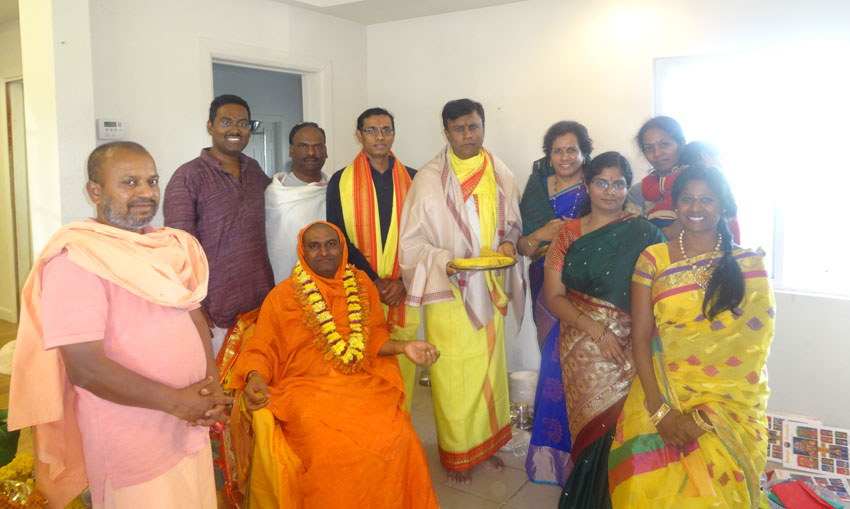 Swamiji with event organizers.