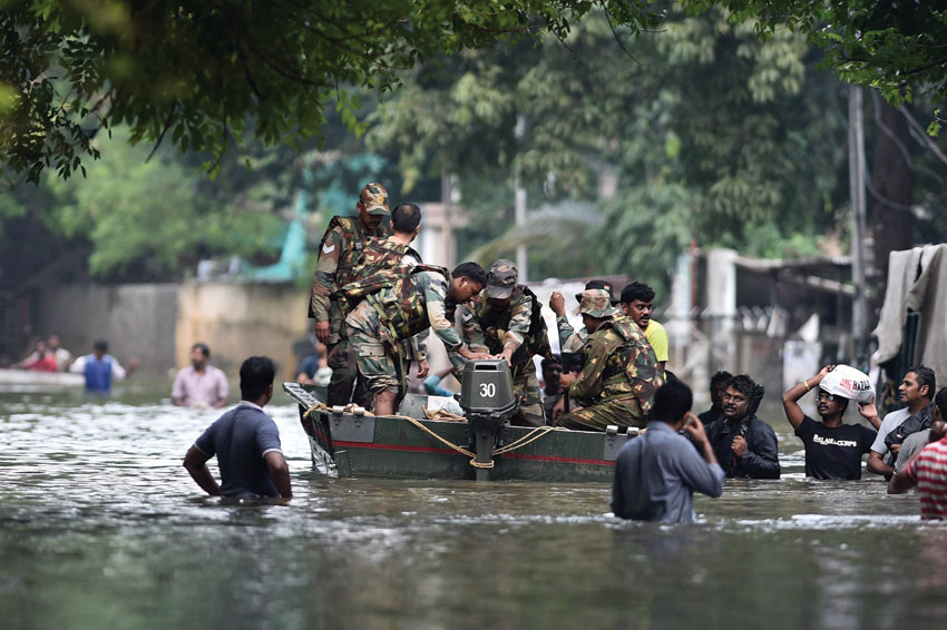 Army personnel rescuing people from a flooded locality in Chennai after heavy rainfall, Dec. 3. (Press Trust of India)