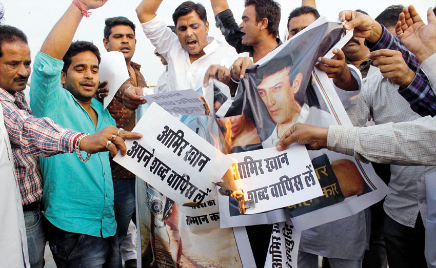 Youth display posters during a protest against actor #AamirKhan following his remarks over growing intolerance in the country in Jaipur, Nov. 26. (Press Trust of India)