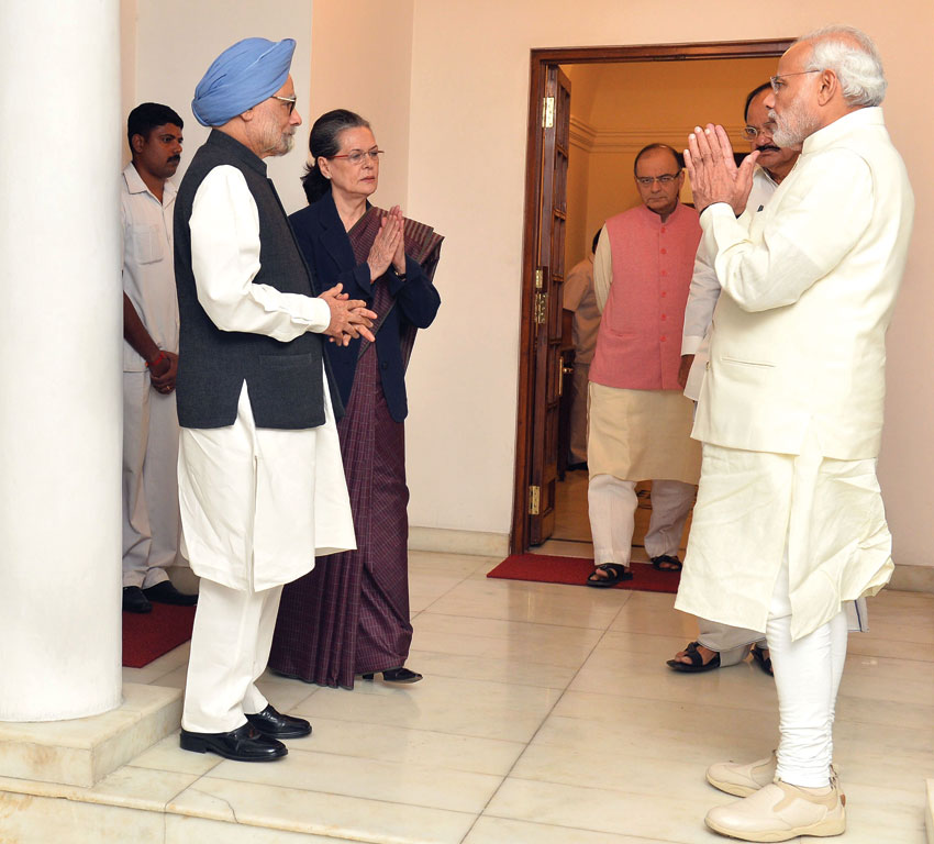 Prime Minister Narendra Modi meets the former Prime Minister, Dr. Manmohan Singh, and Congress President Sonia Gandhi, in New Delhi, Nov. 27. (Press Information Bureau)