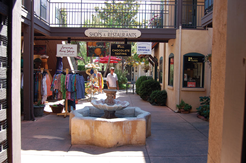 Shoppers find colorful and romantic themed courts just off the main plaza. (Al Auger)