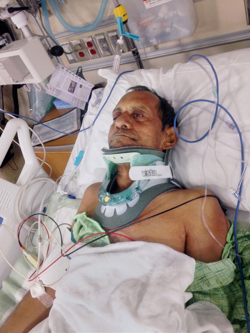 File photo of Sureshbhai Patel, who was paralyzed after a police officer violently frisked him and pulled him to the ground in Madison, Alabama, in February of last year, at the hospital. (Press Trust of India)