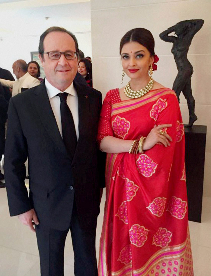 French President Francois Hollande with actress Aishwarya Rai Bachchan at a special luncheon in New Delhi, Jan. 27. (PTI Photo | Twitter)