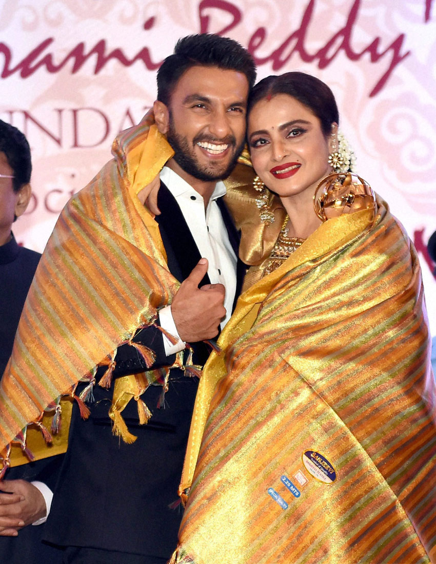 Ranbir Singh felicitates veteran actress Rekha during the 3rd Yash Chopra Memorial award which was conferred to her in Mumbai, Jan. 25. (Mitesh Bhuvad | PTI)