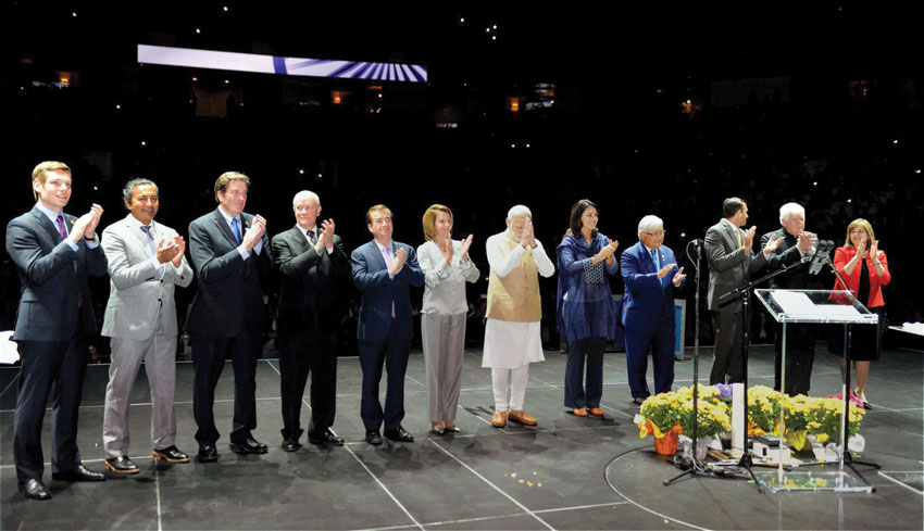 File photo of Prime Minister Narendra Modi greets the audience as top U.S. politicos cheer at SAP Center in San Jose, Calif., during the PM's historic Silicon Valley visit in September, last year. (Press Trust of India)