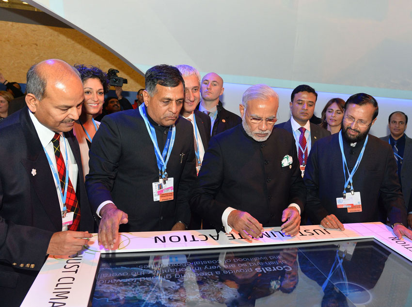 Prime Minister Narendra Modi visiting the India Pavilion, at COP21 Summit, in Paris, Nov. 30. Minister of State for Environment, Forest and Climate Change (Independent Charge), Prakash Javadekar, and the Secretary, Ministry of Environment, Forest and Climate Change, Ashok Lavasa, are also seen. (Press Information Bureau)