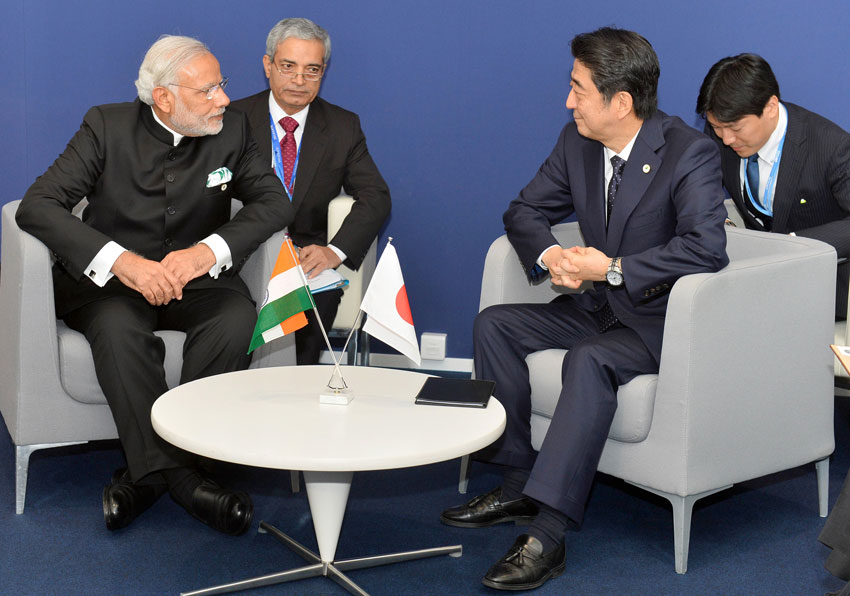 Prime Minister Narendra Modi meeting Japanese Prime Minister Shinzo Abe, on the sidelines of COP21 Summit, in Paris, Nov. 30. (Press Information Bureau)