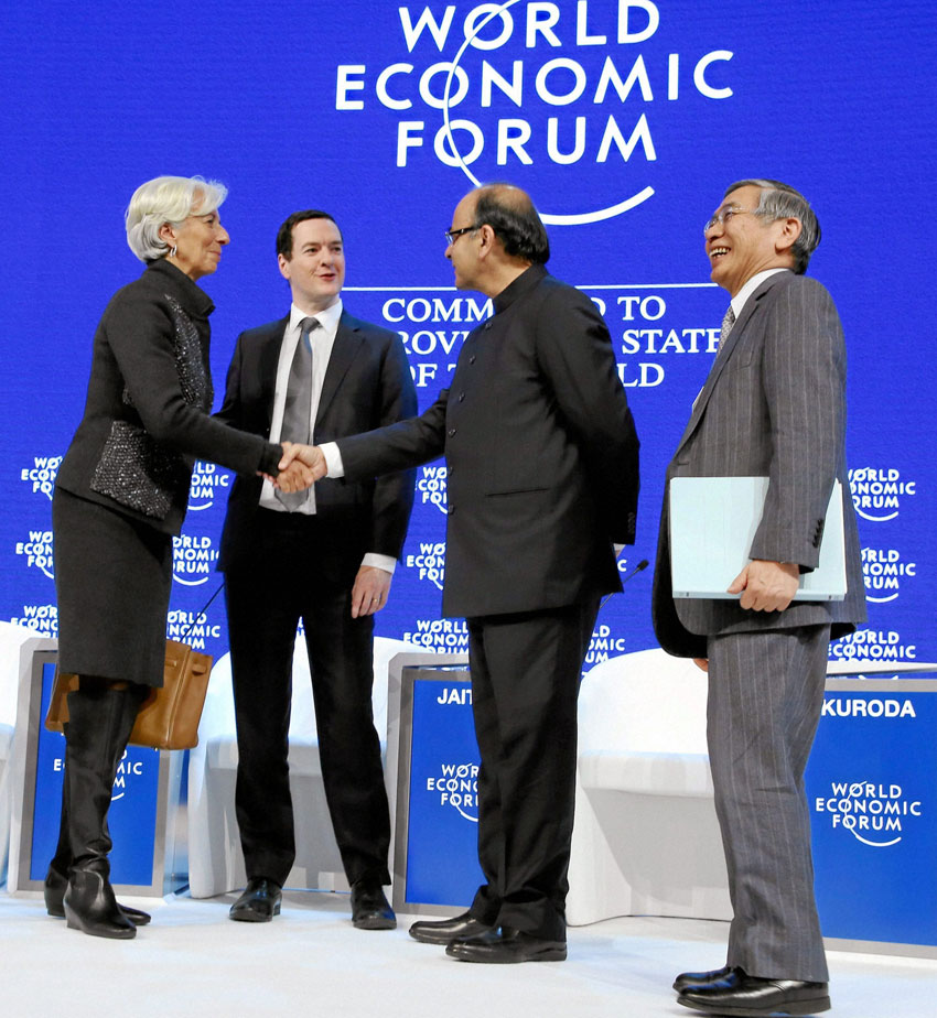 Indian Finance Minister Arun Jaitley shakes hands with Christine Lagarde, managing director, International Monetary Fund, at a session at the World Economic Forum in Davos, Switzerland, Jan. 23. (Press Trust of India)