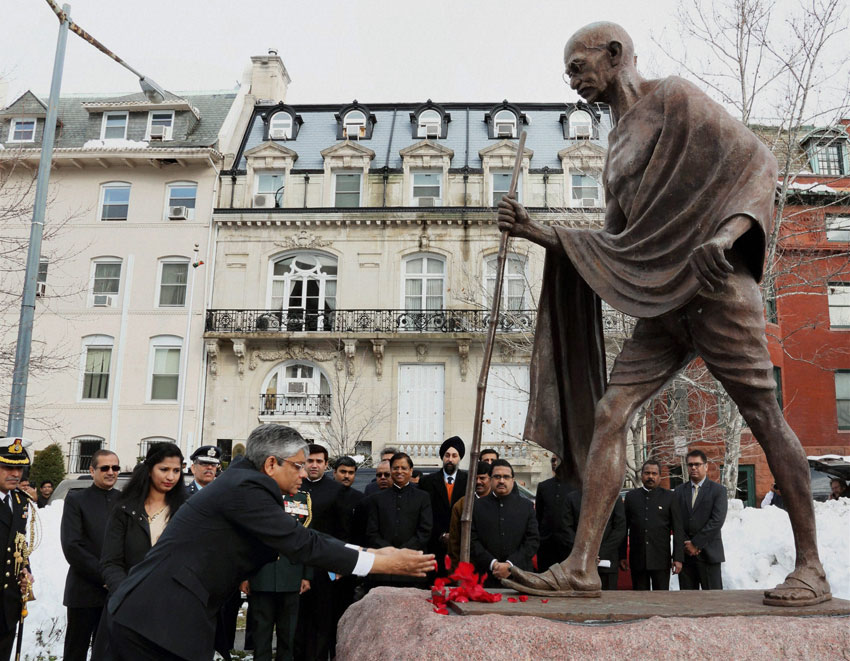 Ambassador Arun K. Singh paying floral tribute to the statue of Mahatma Gandhi on the occasion of India's 67th Republic Day at Embassy of India in Washington, DC, Jan. 26. (Press Trust of India)