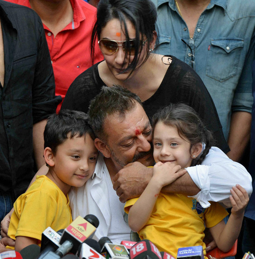 Sanjay Dutt, with his wife Manyata, and children Shahran and Iqra, during a press conference at his residence in Mumbai, Feb. 25. Dutt walked free, Feb. 25, after completing his five-year prison sentence for illegal weapons possession in a case linked to the 1993 serial bomb blasts. (Press Trust of India)