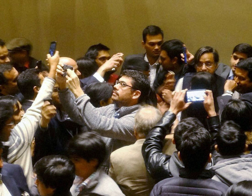 Indian students at Harvard Business School throng Shashi Tharoor for a selfie after he delivered a key note address at the Annual India Conference of Harvard University in Boston, Mass., Feb. 7. (Press Trust of India)