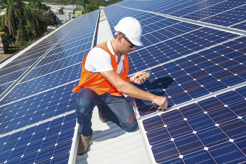 A U.S. technician working with solar panels.