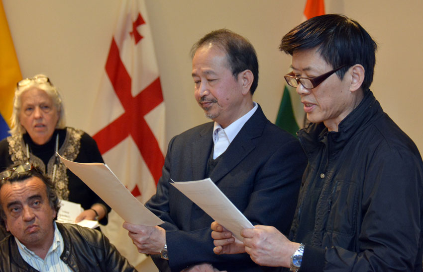 A consumer (r), talks about how he was scammed at an auto dealership in Sunnyvale, Calif., speaks to ethnic media at World Affairs Center in San Francisco, Feb. 11. He does not know English and spoke in Chinese, which was translated by an interpreter, (seen on his left). (Amar D. Gupta | Siliconeer)