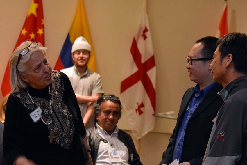 A consumer (r), shared his story of how he was scammed at an automobile service center, with the ethnic media at World Affairs Center in San Francisco, Feb. 11. As he did not know English, an interpreter (2nd from r) spoke on his behalf. Also seen are NAM Executive Director Sandy Close (l), Martin, a student from UC Davis (standing, 2nd from l), and another ethnic media representative. (Amar D. Gupta | Siliconeer)