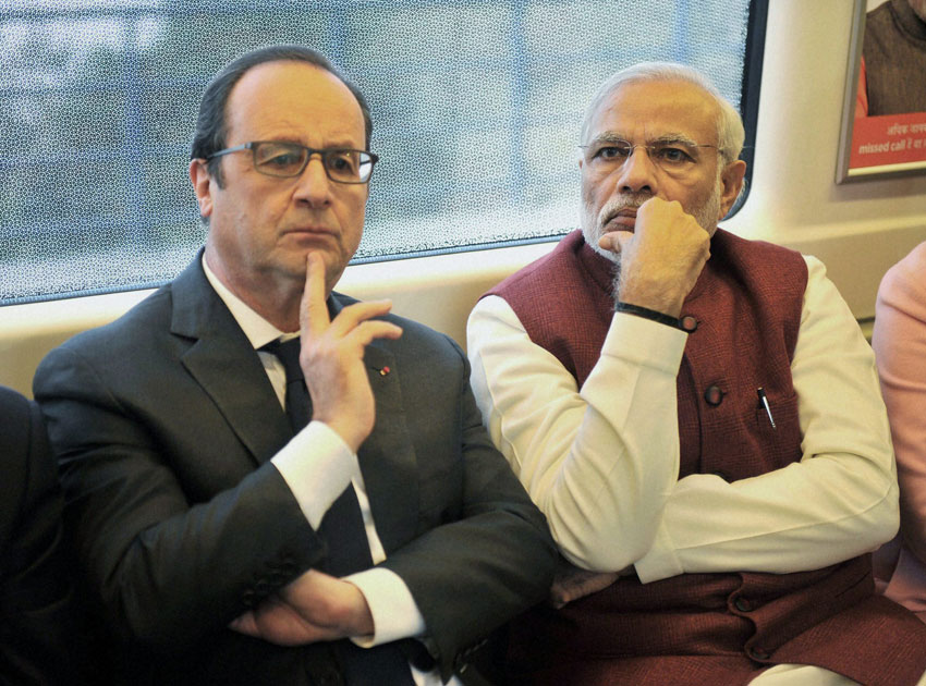 Prime Minister Narendra Modi and French President Francois Hollande travel by Metro train to Gurgaon for inauguration of the headquarters of the 102-nation International Solar Alliance, Jan. 25. (Press Trust of India)