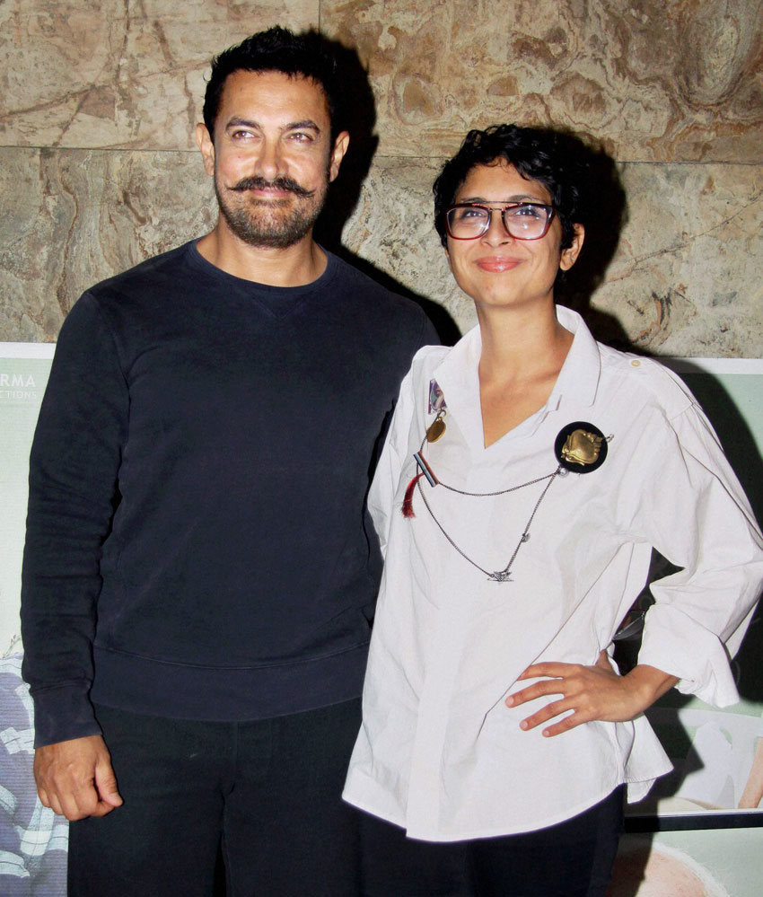 "Aamir Khan with wife Kiran Rao at the screening of ""Kapoor and Sons"" in Mumbai, Mar. 15. (Press Trust of India)"