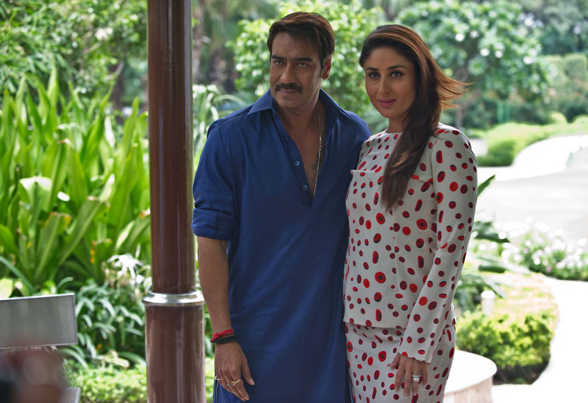 "File photo of Ajay Devgn (l) and Kareena Kapoor Khan as they attend a promotional event for ""Singham Returns,"" in New Delhi, Aug. 11, 2014. (Prakash Singh 