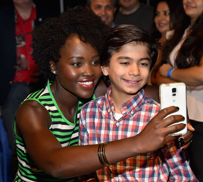 "File photo of Lupita Nyong'o (l) and Neel Sethi of ""The Jungle Book"" as they take part in ""Worlds, Galaxies, and Universes: Live Action at The Walt Disney Studios"" presentation at Disney's D23 EXPO 2015, Aug. 15, in Anaheim, Calif.  (Alberto E. Rodriguez 