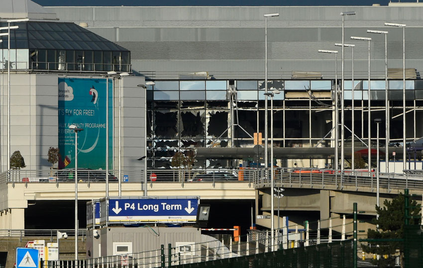 The shattered glass facade of the departure hall of Brussels Airport in Zaventem following twin blasts on Mar. 22. A series of apparently coordinated explosions ripped through Brussels airport and a metro train, killing at least 35 people in the latest attacks to target Europe. (John Thys | AFP | Getty Images)
