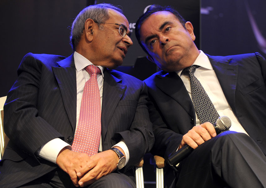 File photo of co-chairman of Hinduja Group, G.P. Hinduja, and CEO and chairman of Renault-Nissan, Carlos Ghosn (r) as they share a point during the launch of Hinduja Group's flagship brand, Ashok Leyland's multi-purpose vehicle 'STILE,' in Chennai, July 16, 2013. (Manjunath Kiran | AFP | Getty Images)