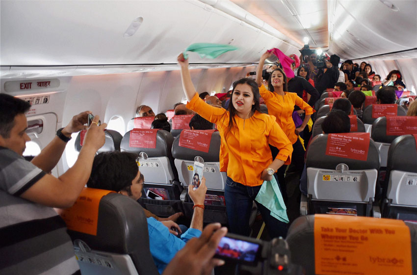 Inflight crew on board a SpiceJet Delhi-Goa flight perform a Holi dance post boarding before take off in New Delhi, Mar. 22. (Shirish Shete   PTI)