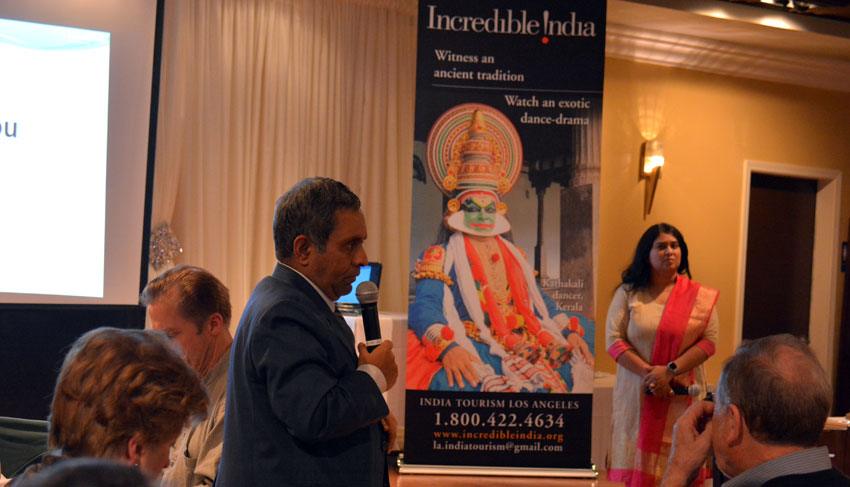 Consul General of India at San Francisco, Ambassador Venkatesan Ashok addressing the audience as India Tourism Los Angeles assistant director Sandhya Haridas (r) looks on, at the Know India seminar at Amber in Los Altos, Calif., Mar. 7. (Amar D. Gupta | Siliconeer)
