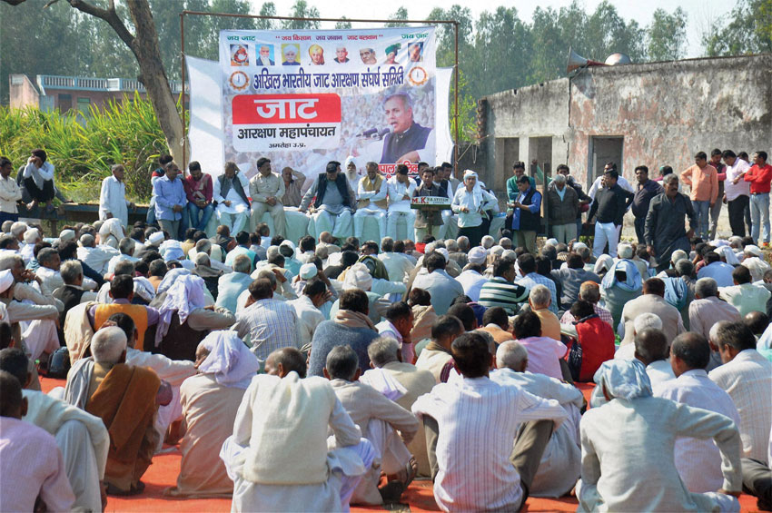 Jat community members holding a meeting for reservations, in Amroha, U.P, Feb. 23. (Press Trust of India)