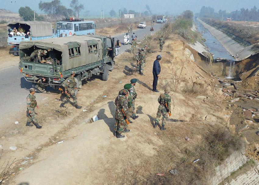 Army personnel standing near a canal that was damaged by the Jat people during their agitation for reservation, at Rohat village in Sonepat, Feb. 23. (Press Trust of India)