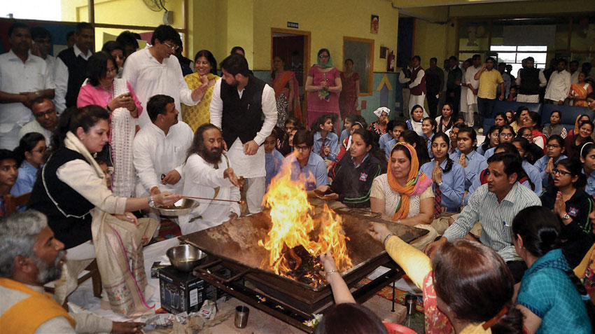 Spiritual leader Sri Sri Ravi Shankar performs a hawan along with the staff and students of a school that was torched during the Jat agitation, in Rohtak, Haryana, Feb. 27. (Press Trust of India)