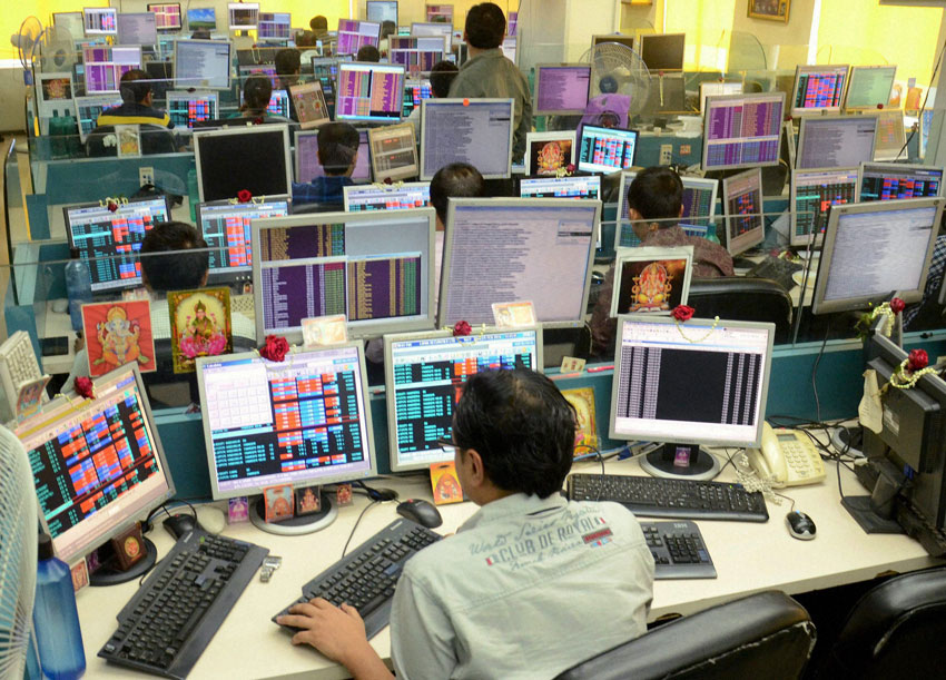 Share brokers watch the stock prices on their systems during Union Budget 2016-17 presentation in Parliament, in Kolkata, Feb. 29. (Press Trust of India)